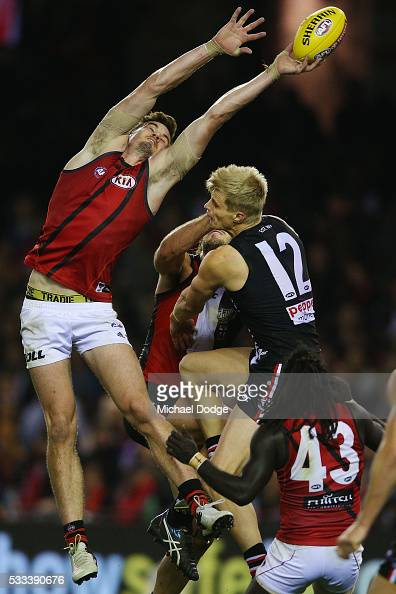 Michael Hartley of the Bombers and Nick Riewoldt of the Saints compete for the ball during the round nine AFL match between the St Kilda Saints and...