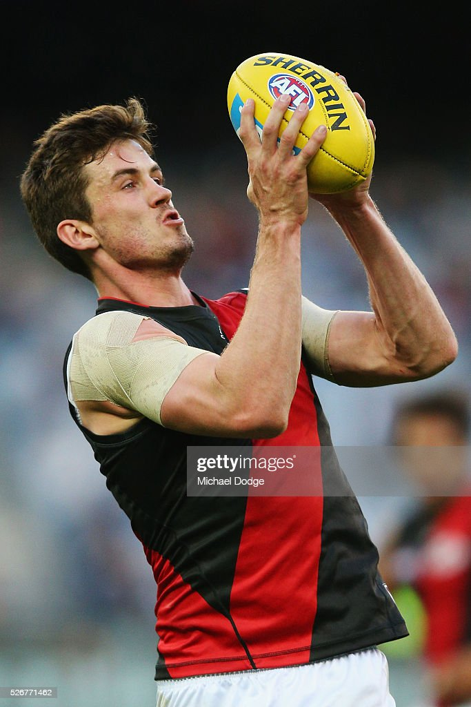 Michael Hartley of the Bombers marks the ball during the round six AFL match between the Carlton Blues and the Essendon Bombers at Melbourne Cricket Ground on May 1, 2016 in Melbourne, Australia.