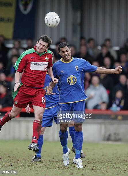 LONDON February 18 Michael Harvey of AFC Wimbledon heads the ball against David Warner of Windsor Eton during the Ryman League Premier Division match...