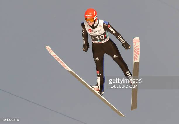 Michael Hayboeck from Austria soars during the FIS Ski Jumping World Cup Men´s Team HS225 in Vikersund on March 18 2017 / AFP PHOTO / NTB Scanpix /...