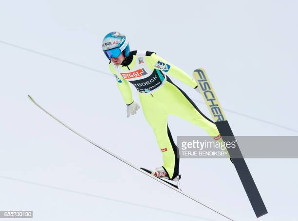 Michael Hayboeck from Austria soars during trial round of FIS Ski Jumping World Cup Men´s HS225 in Vikersund on March 19 2017 / AFP PHOTO / NTB...