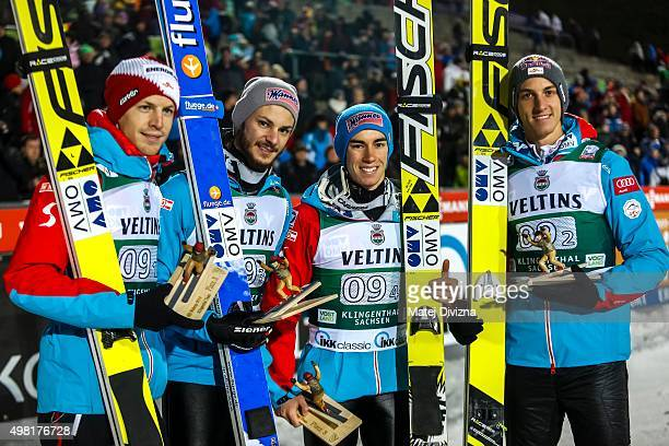 Michael Hayboeck Manuel Fettner Stefan Kraft and Gregor Schlierenzauer of Austria pose for photographers after placing third at team competition...