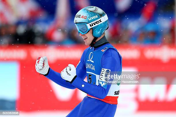 Michael Hayboeck of Austria celebrates after his jump at the Flying Hill team competition of the FIS Ski Flying World Championship 2016 during day 4...