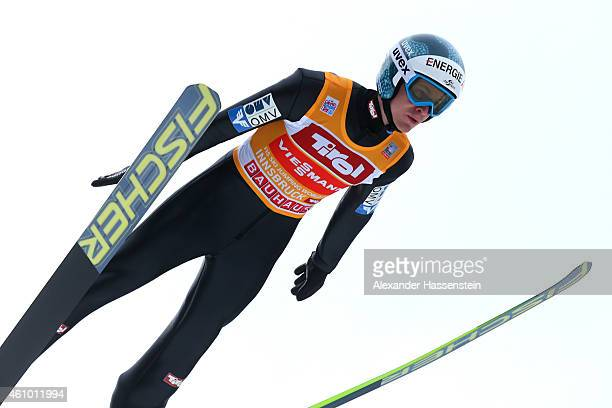 Michael Hayboeck of Austria competes at the trail jump on day 6 of the Four Hills Tournament Ski Jumping event at BergiselSchanze on January 4 2015...