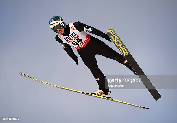 Michael Hayboeck of Austria competes during the Men's HS100 Normal Hill Ski Jumping trial during the FIS Nordic World Ski Championships at the Lugnet...