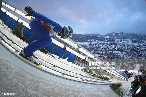 Michael Hayboeck of Austria competes on day 1 of the Four Hills Tournament Ski Jumping event at SchattenbergSchanze Erdinger Arena on December 27...