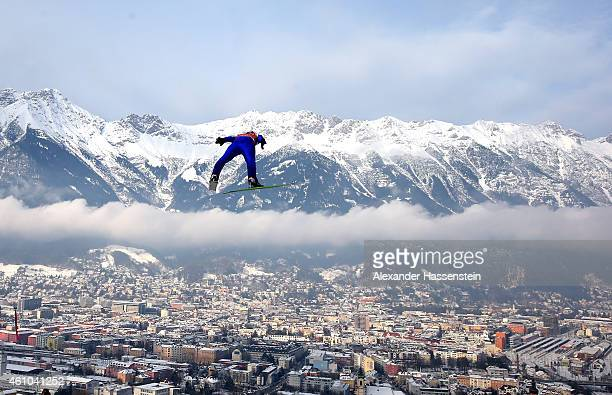 Michael Hayboeck of Austria competes on day 5 of the Four Hills Tournament Ski Jumping event at BergiselSchanze on January 3 2015 in Innsbruck Austria