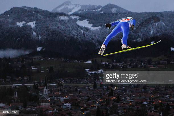 Michael Hayboeck of Austria in action during the FIS Ski Jumping World Cup Vierschanzentournee on December 29 2013 in Oberstdorf Germany