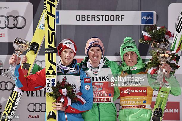Michael Hayboeck of Austria Severin Freund of Germany and Peter Prevc of Slovenia pose at the podium after Day 2 of the 64th Four Hills Tournament...