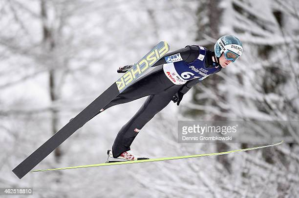 Michael Hayboeck of Austria soars through the air during his first training jump on Day One of the FIS Ski Jumping World Cup on January 30 2015 in...
