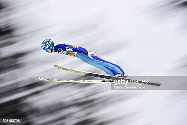 Michael Hayboeck of Austria soars through the air during his qualification jump on day 1 of the 64th Four Hills Tournament ski jumping event on...