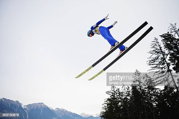 Michael Hayboeck of Austria soars through the air during his training jump on day 1 of the 64th Four Hills Tournament ski jumping event on January 2...