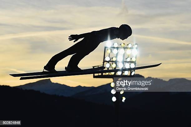 Michael Hayboeck of Austria soars through the air during his trial jump on Day 2 of the 64th Four Hills Tournament event on December 29 2015 in...