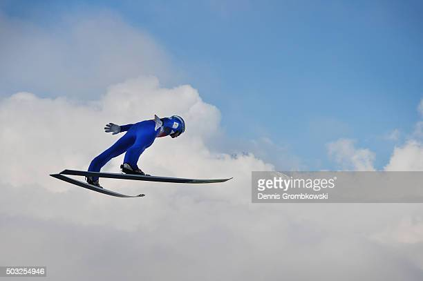Michael Hayboeck of Austria soars through the air during his trial jump on Day 2 of the Innsbruck 64th Four Hills Tournament ski jumping event on...