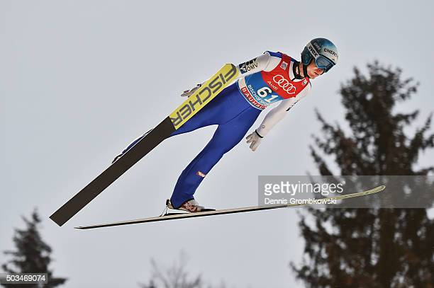 Michael Hayboeck of Austria soars through the air during his trial jump on Day 1 of the Bischofshofen 64th Four Hills Tournament ski jumping event on...