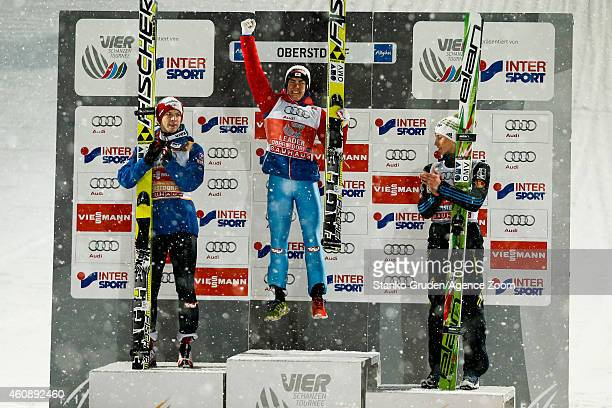 Michael Hayboeck of Austria takes 2nd palce Stefan Kraft of Austria takes 1st placePeter Prevc of Slovenia takes 3rd during the FIS Ski Jumping World...