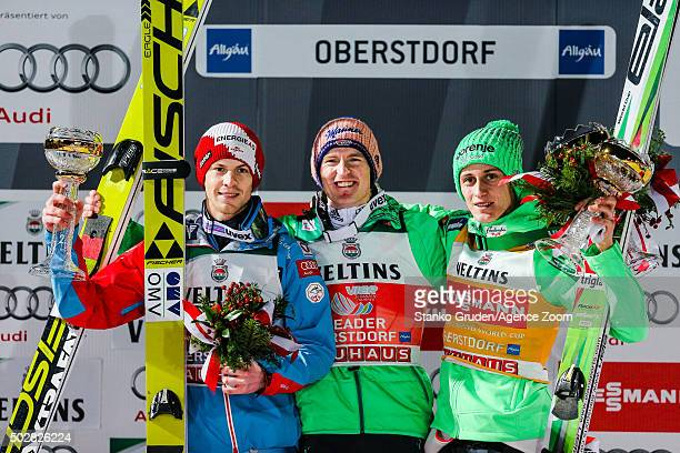 Michael Hayboeck of Austria takes 2nd place Severin Freund of Germany takes 1st place Peter Prevc of Slovenia takes 3rd place during the FIS Nordic...