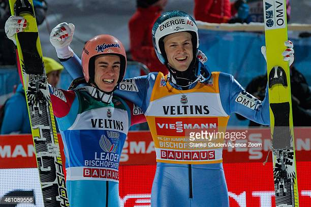 Michael Hayboeck of Austria takes 2nd place Stefan Kraft of Austria takes 1st place during the FIS Ski Jumping World Cup Vierschanzentournee on...