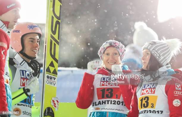 Michael Hayboeck Stefan Kraft Daniela IraschkoStolz Jacqueline Seifriedsberger of Austria team react during the Mixed Team HS100 Normal Hill Ski...