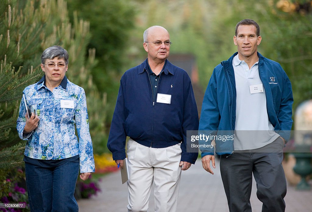 Michael Hayden, principal of the Chertoff Group, center, his wife Jeanine, and Ynon Kreiz, chief executive officer of Endemol NV, right, arrive for morning sessions at the 28th annual Allen & Co. Media and Technology Conference in Sun Valley, Idaho, U.S., on Saturday, July 10, 2010. Allen & Co., the boutique New York investment bank, invites executives from start-ups in media and technology to mingle with bankers and moguls at the event. The mixture, along with presentations trumpeting new business models, has led to acquisitions and investments in the past. Photographer: Matthew Staver/Bloomberg via Getty Images