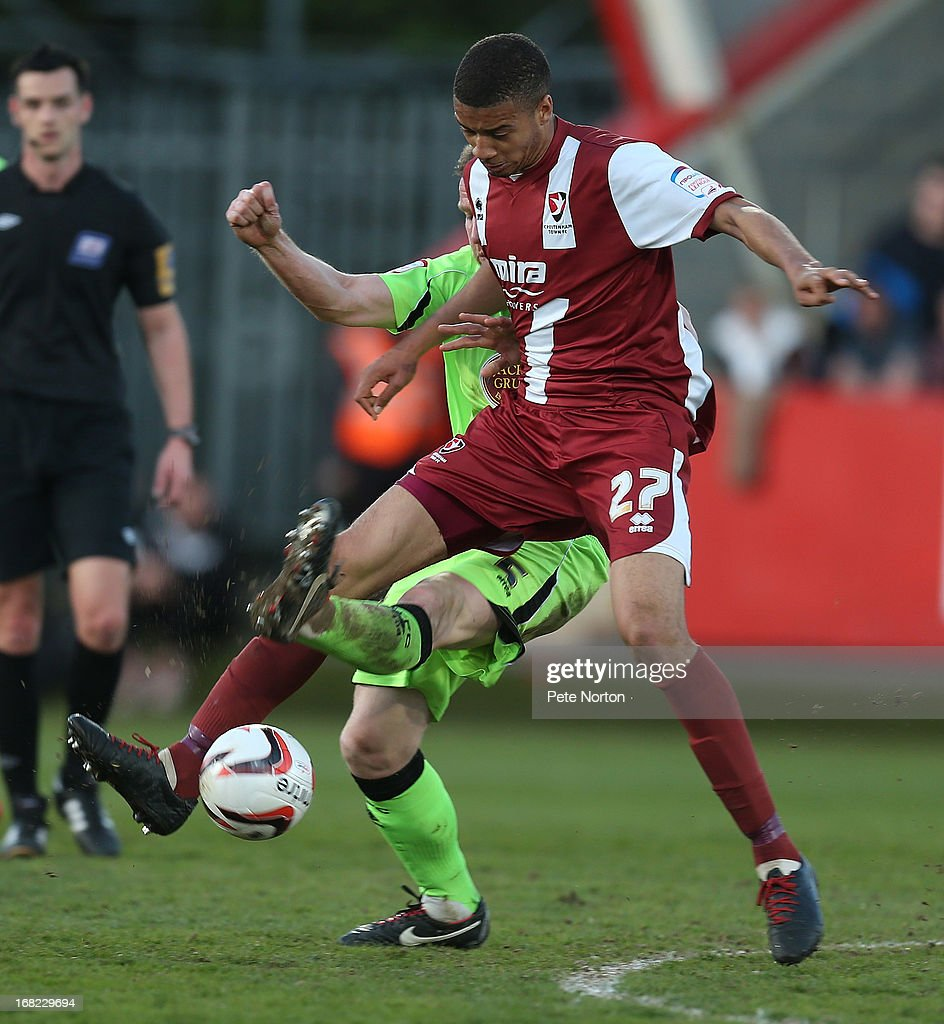 Michael Hector of Cheltenham Town attempts to control the ball under pressure from Kelvin Langmead of Northampton Town during the npower League Two Play Off Semi Final Second Leg between Cheltenham Town and Northampton Town at Abbey Business Stadium on May 5, 2013 in Cheltenham, England.