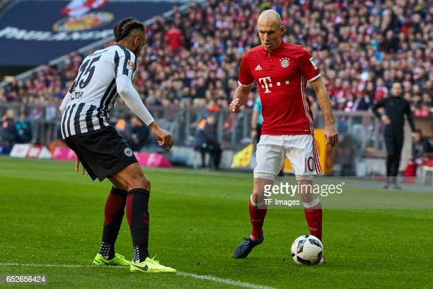 Michael Hector of Frankfurt and Arjen Robben of Muenchen battle for the ball during the Bundesliga match between Bayern Muenchen and Eintracht...
