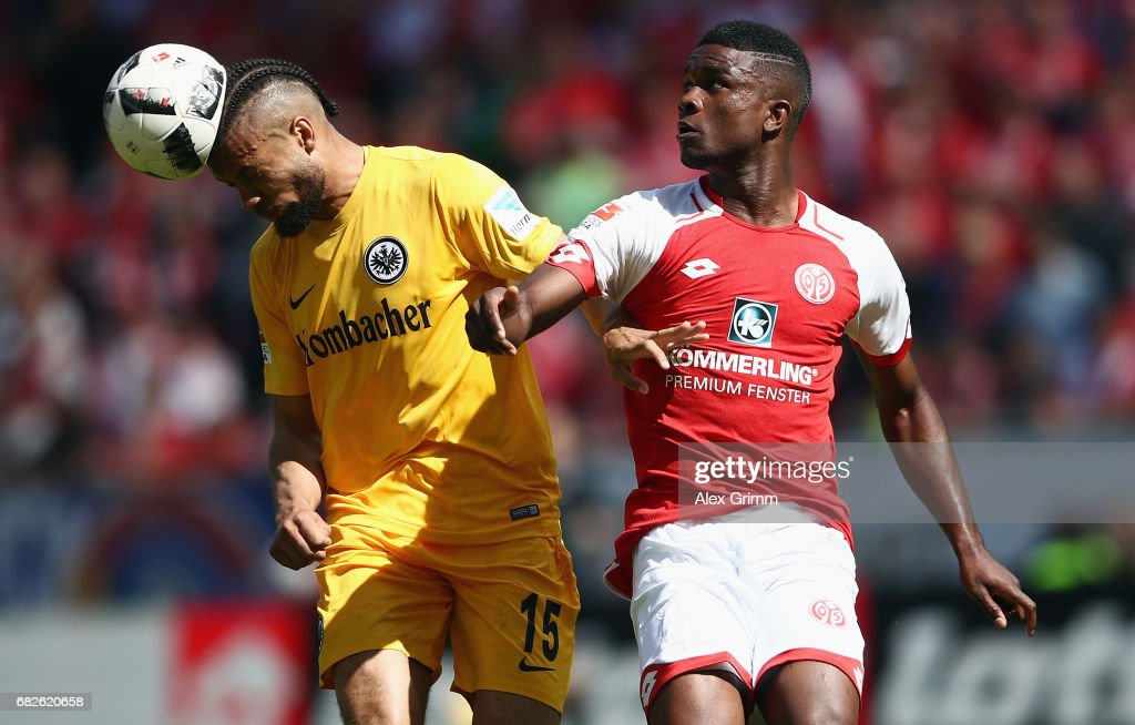 Michael Hector (L) of Frankfurt is challenged by Jhon Cordoba of Mainz during the Bundesliga match between 1. FSV Mainz 05 and Eintracht Frankfurt at Opel Arena on May 13, 2017 in Mainz, Germany.