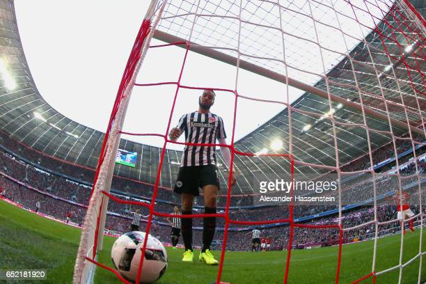 Michael Hector of Frankfurt reacts receiving the first goal during the Bundesliga match between Bayern Muenchen and Eintracht Frankfurt at Allianz...