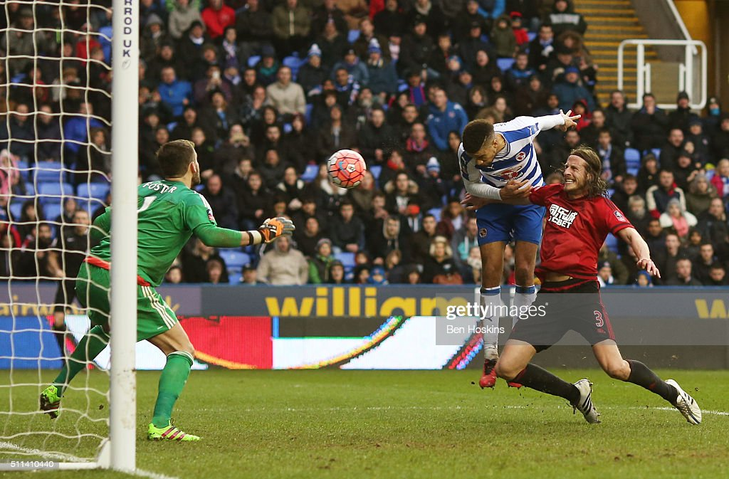 Michael Hector (C) of Reading heads the ball to score his team's second goal during the Emirates FA Cup fifth round match between Reading and West Bromwich Albion at the Madejski Stadium on February 20, 2016 in Reading, England.