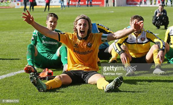 Michael Hefele of Dresden and his team mates celebrate with their supporters after winning the third league match between FC Energie Cottbus and SG...