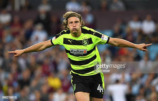 Michael Hefele of Huddersfield Town celebrates scoring his sides first goal during the Sky Bet Championship match between Aston Villa and...