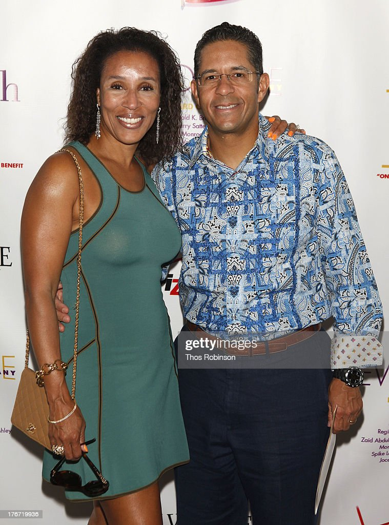 Michael Heningburg and Jeanine B. Downie attend Evidence, A Dance Company Hosts 10th Annual 'On Our Toes'... In The Hamptons Summer Benefit at The Hayground School on August 17, 2013 in Bridgehampton, New York.