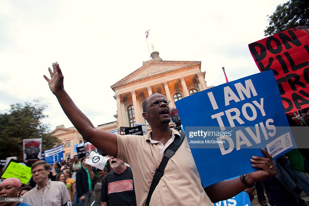 Michael Henry and other protesters for Troy Davis gather on the steps of the Georgia Capitol building on September 20, 2011 in Atlanta, Georgia. The Georgia Board of Pardons and Paroles denied clemency for death row inmate Troy Davis on Tuesday morning. Davis is scheduled to die Wednesday for the 1989 slaying of off-duty Savannah, Georgia police officer Mark MacPhail after being on death row for nearly two decades.