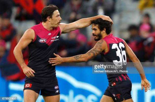 Michael Hibberd and Jeff Garlett of the Demons celebrate during the 2017 AFL round 07 match between the Melbourne Demons and the Hawthorn Hawks at...