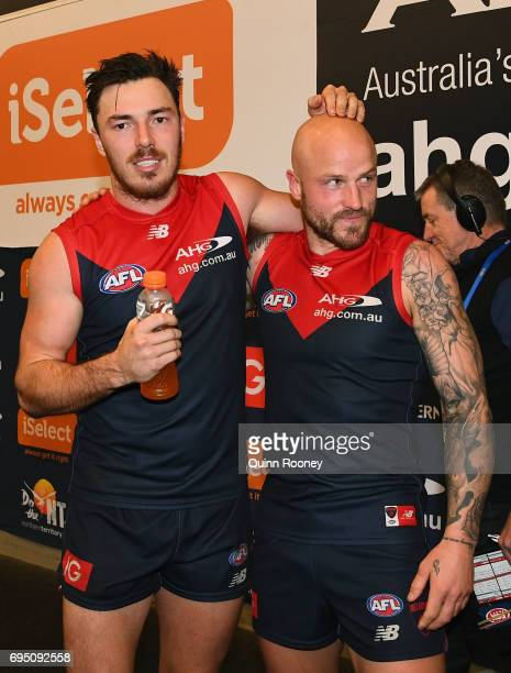 Michael Hibberd and Nathan Jones of the Demons celebrate in the rooms after winning the round 12 AFL match between the Melbourne Demons and the...
