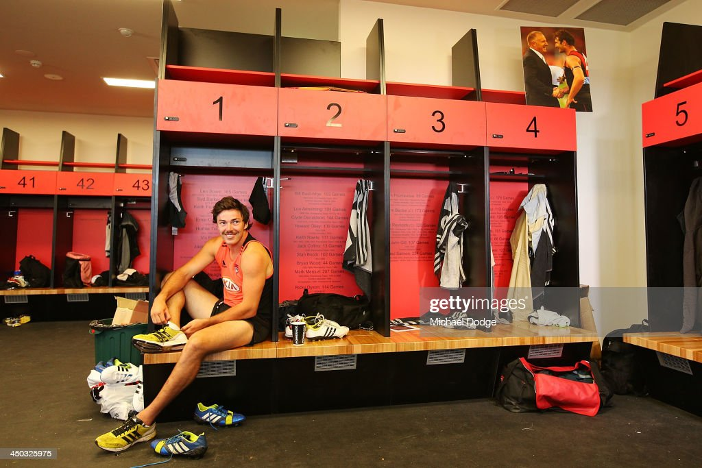 Michael Hibberd gets dressed in the changerooms at the new Essendon Bombers AFL training facility at Tullamarine on November 18, 2013 in Melbourne, Australia.