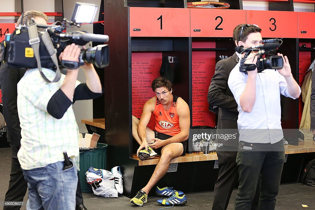 Michael Hibberd gets dressed in the changerooms while media go on a tour at the new Essendon Bombers AFL training facility at Tullamarine on November 18, 2013 in Melbourne, Australia.