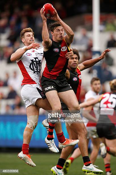 Michael Hibberd of the Bombers marks the ball during the round 15 AFL match between the Essendon Bombers and the Melbourne Demons at Melbourne...
