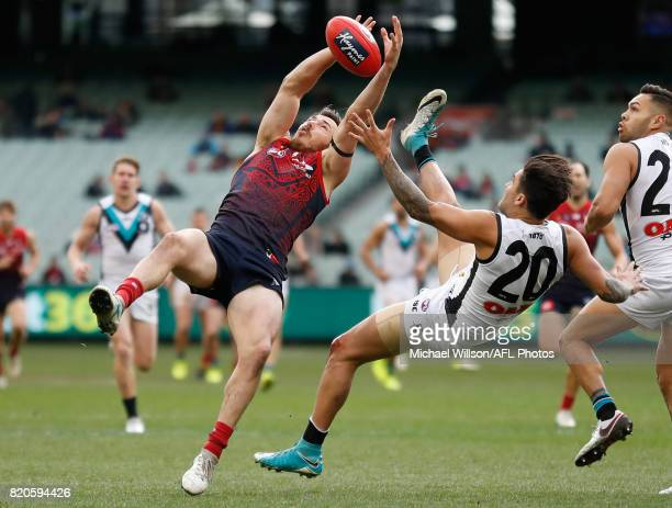Michael Hibberd of the Demons and Chad Wingard of the Power compete for the ball during the 2017 AFL round 18 match between the Melbourne Demons and...