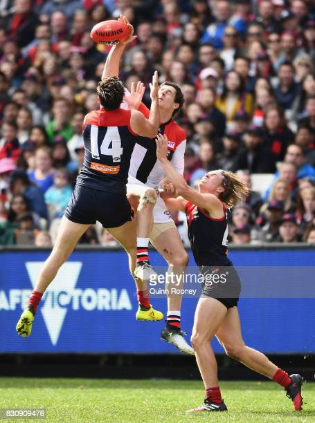 Michael Hibberd of the Demons and Jake Carlisle of the Saints compete for a mark during the round 21 AFL match between the Melbourne Demons and the...