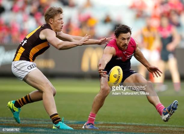 Michael Hibberd of the Demons and James Sicily of the Hawks compete for the ball during the 2017 AFL round 07 match between the Melbourne Demons and...