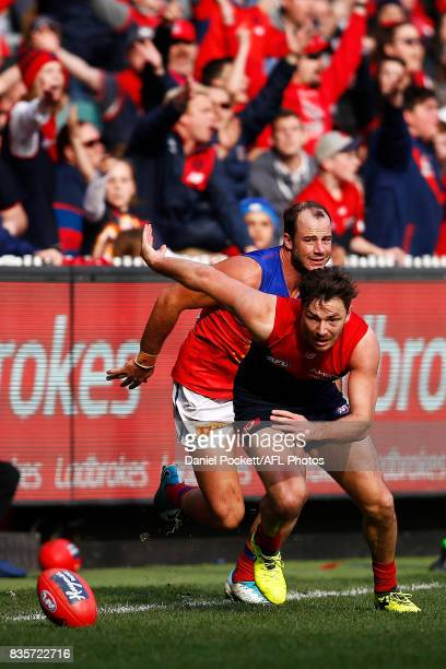 Michael Hibberd of the Demons and Josh Walker of the Lions contest the ball during the round 22 AFL match between the Melbourne Demons and the...