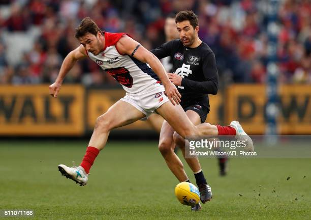 Michael Hibberd of the Demons and Kade Simpson of the Blues compete for the ball during the 2017 AFL round 16 match between the Carlton Blues and the...