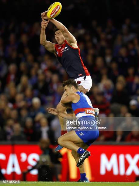 Michael Hibberd of the Demons and Luke Dahlhaus of the Bulldogs compete for the ball during the 2017 AFL round 13 match between the Western Bulldogs...