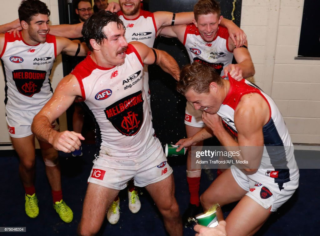 Michael Hibberd of the Demons drags Jake Melksham of the Demons into the circle as he gets a Gatorade shower during the 2017 AFL round 06 match between the Essendon Bombers and the Melbourne Demons at Etihad Stadium on April 30, 2017 in Melbourne, Australia.