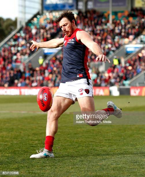 Michael Hibberd of the Demons kicks the ball during the 2017 AFL round 19 match between the North Melbourne Kangaroos and the Melbourne Demons at...
