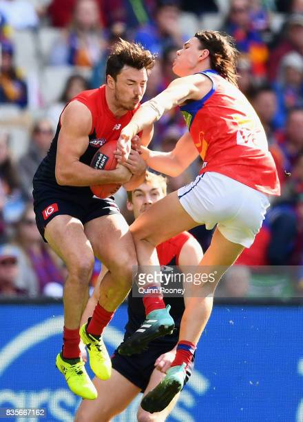 Michael Hibberd of the Demons marks infront of Eric Hipwood of the Lions during the round 22 AFL match between the Melbourne Demons and the Brisbane...