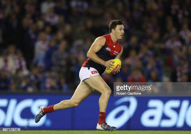 Michael Hibberd of the Demons runs with the ball during the round 13 AFL match between the Western Bulldogs and the Melbourne Demons at Etihad...