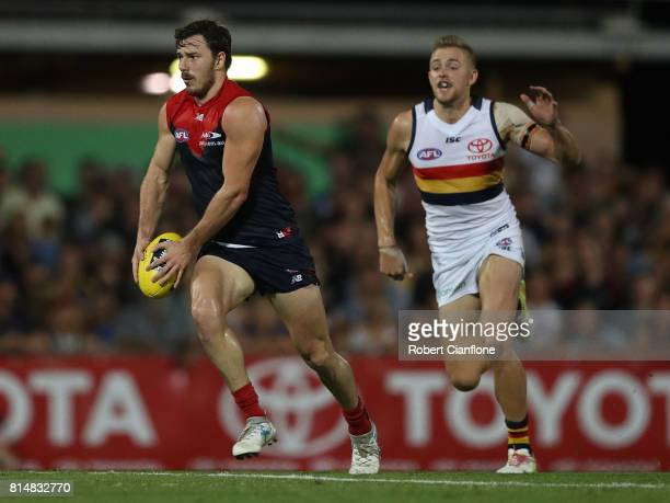 Michael Hibberd of the Demons runs with the ball during the round 17 AFL match between the Melbourne Demons and the Adelaide Crows at TIO Stadium on...
