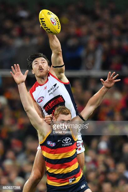 Michael Hibberd of the Demons spoils the ball over Tom Lynch of the Crows during the round eight AFL match between the Adelaide Crows and the...